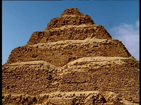 tilt up pyramid djoser to blue sky saqqara - saqqara stock videos and b-roll footage