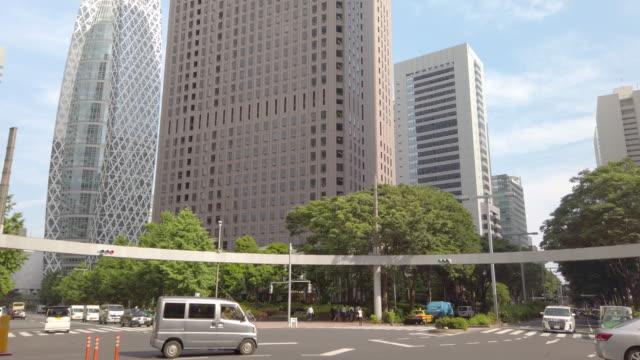4k tilt up realtime. shinjuku mitsui building and cityscape office at nishi-shinjuku in tokyo , japan . - tilt up stock videos & royalty-free footage