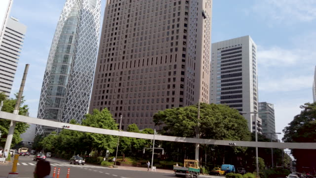 4k tilt up realtime. shinjuku mitsui building and cityscape office at nishi-shinjuku in tokyo , japan . - film tilt stock videos & royalty-free footage