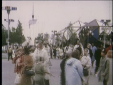 1964 tilt up rear view 3 boy scouts run thru crowd at ny world's fair - 1964年点の映像素材/bロール
