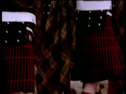 tilt up servicemen in kilts taking part in parade - kilt stock videos & royalty-free footage