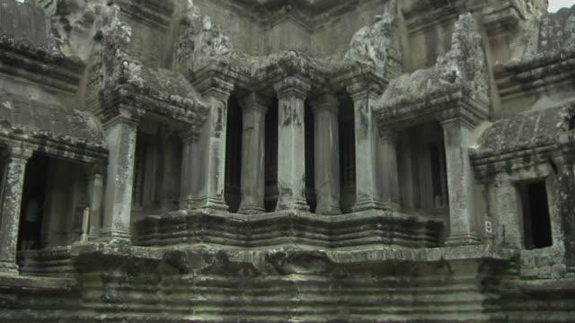 tilt up shot angkor wat tower siem reap cambodia - natural column stock videos and b-roll footage
