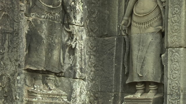 tilt up shot bay on temple architecture siem reap cambodia - female likeness stock videos & royalty-free footage