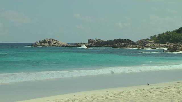 tilt up shot beach praslin victoria mahe seychelles - seychelles stock videos & royalty-free footage