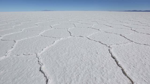 tilt up shot of a salt field in bolivia - salt flat stock videos & royalty-free footage