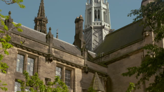 tilt up shot of famous historic church towers in city against sky on sunny day - glasgow, scotland - cathedral stock videos & royalty-free footage