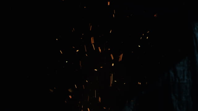 tilt up shot of fire sparks at night. - particle stock videos & royalty-free footage