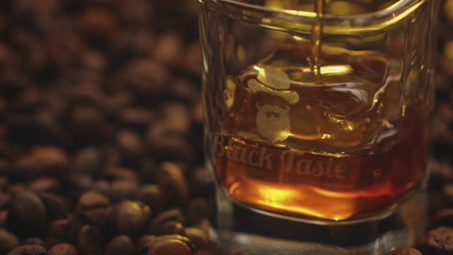 tilt up shot of liqueur being poured in glass - coffee drink stock videos & royalty-free footage