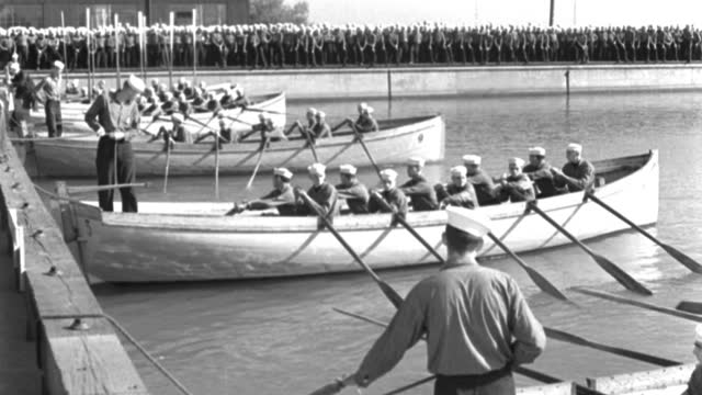 tilt up shot of men in uniforms waiting for signal at basin dock before boat race - 1944 stock videos & royalty-free footage