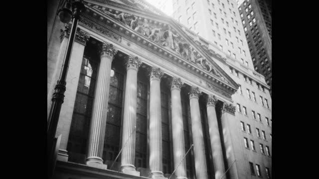 tilt up shot of new york stock exchange building, wall street, lower manhattan, new york city, new york state, usa - tilt up stock videos & royalty-free footage
