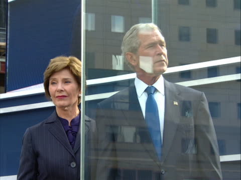 tilt up shot of president bush and his wife laura listening to the names of victims being read at the 9/11 memorial ceremony held at ground zero on... - laura bush stock videos & royalty-free footage