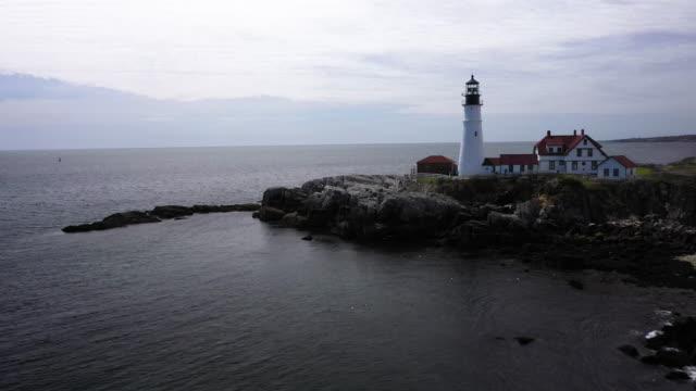 tilt up shot of the portland head light in casco bay - north atlantic ocean stock videos & royalty-free footage