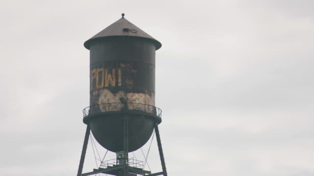tilt up shot of the water tower of the former packard motor car company plant - michigan stock videos & royalty-free footage