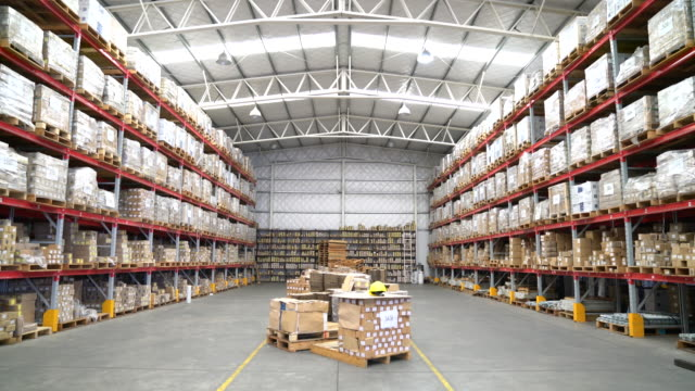 tilt up shot of warehouse - deposito video stock e b–roll