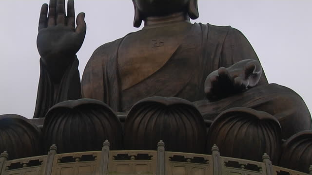 tilt up shot tian tan buddha hong kong kwangtung china - tian tan buddha stock videos and b-roll footage