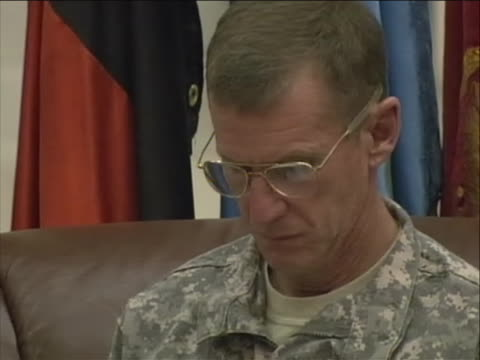 tilt up shots of general stanley mcchrystal, commander of the international security assistance force in afghanistan, wearing glasses and army... - international security assistance force stock videos & royalty-free footage