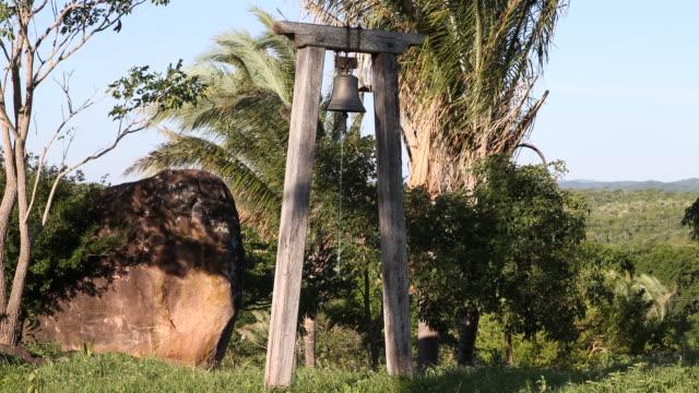 tilt up, showing the church bell of san rafael chapel in surucusí, a small village in el puente community in the guarayos region. the chapel was... - puente stock videos & royalty-free footage