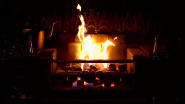 tilt up slow motion shots of brick hearth with burning brushwood - log stock videos & royalty-free footage