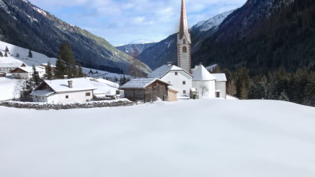 tilt up: st. sigismund im sellrain, tyrol, austria, in winter - tyrol state austria stock videos and b-roll footage