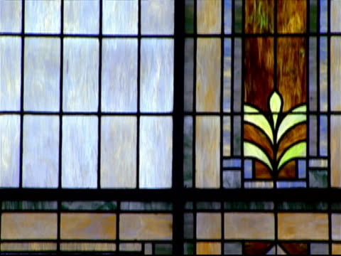 tilt up stained glass window inside baptist church / tilt down - baptist stock videos & royalty-free footage