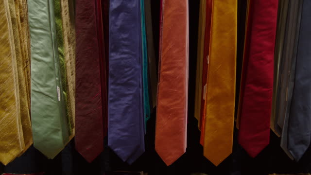 tilt up striking lines of brightly-coloured neckties in a tailors', london, uk. - tie stock videos & royalty-free footage