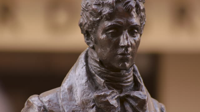tilt up, then down, a statue of beau brummell, 19th century fashion icon, on london's jermyn street, uk. - cravat stock videos and b-roll footage