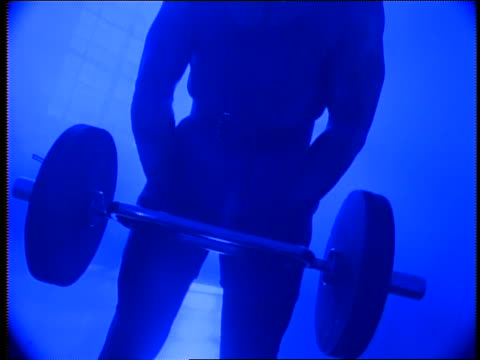 blue silhouette tilt up + tilt down black man lifting barbell in gym - masculinity stock videos & royalty-free footage
