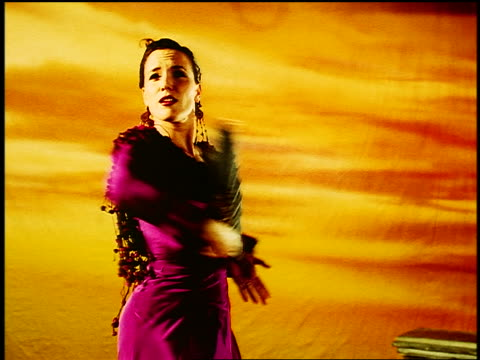 tilt up tilt down from feet to hispanic woman in native dress with fan flamenco dancing in studio - flamenco dancing stock videos and b-roll footage