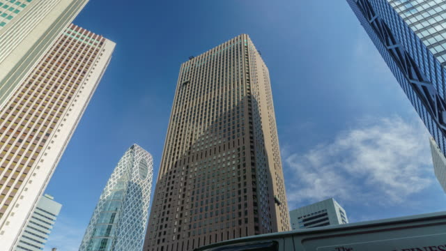 4k tilt up time lapse cityscape office at nishi-shinjuku in tokyo , japan - tilt up stock videos & royalty-free footage