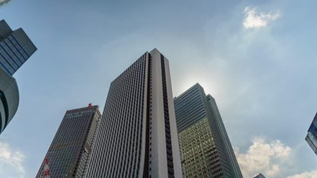 4k tilt up time lapse office building and sky . - tilt up stock videos & royalty-free footage