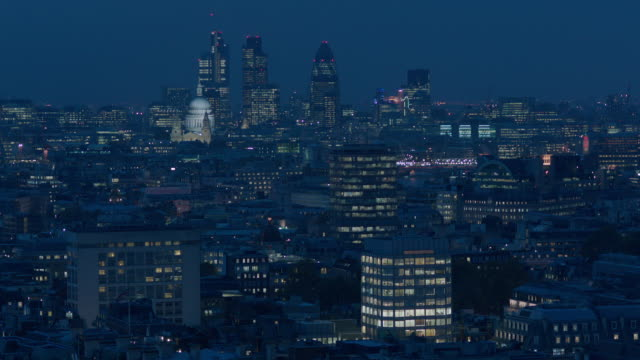 tilt up to a long, twilight shot of buildings of the city of london, uk. - cityscape stock videos & royalty-free footage