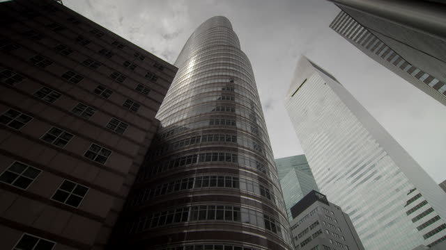 a tilt up to a the lipstick tower in manhattan and a series of nearby skyscrapers on third ave. - lipstick stock videos and b-roll footage