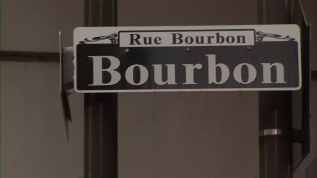 tilt up to bourbon street sign. - bourbon street new orleans stock videos and b-roll footage