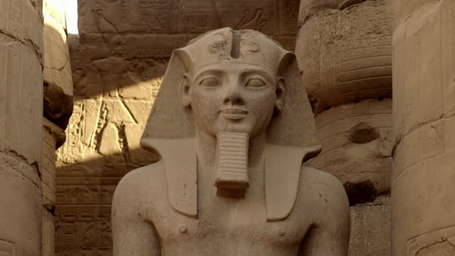 Tilt up to face of Ramses II statue, Temple of Luxor
