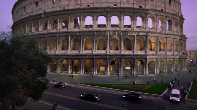 tilt up to illuminated colosseum during the evening. - arch of constantine stock videos and b-roll footage