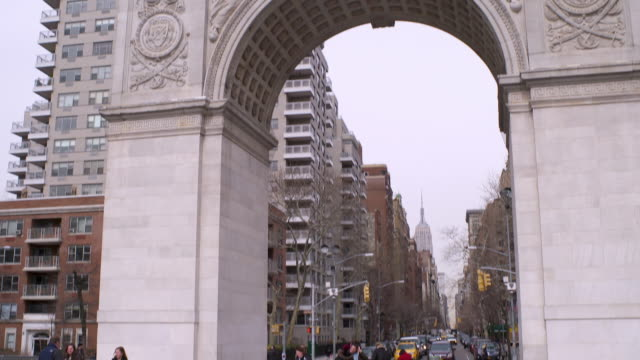 tilt up to the arch in washington square park - animal representation stock videos & royalty-free footage