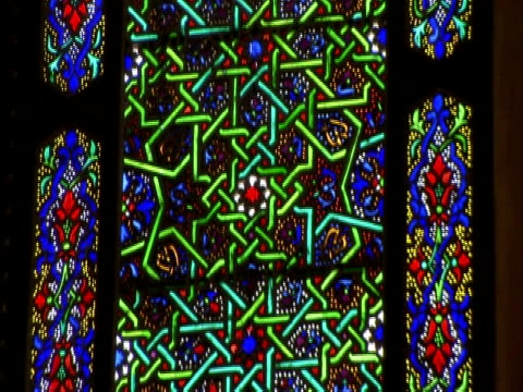 Tilt up to view of Arabic stained glass window, Umayyad mosque, Damascus, Syria (sound available)