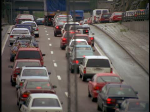 rear view tilt up traffic jam on highway / stockholm, sweden - sweden stock videos & royalty-free footage
