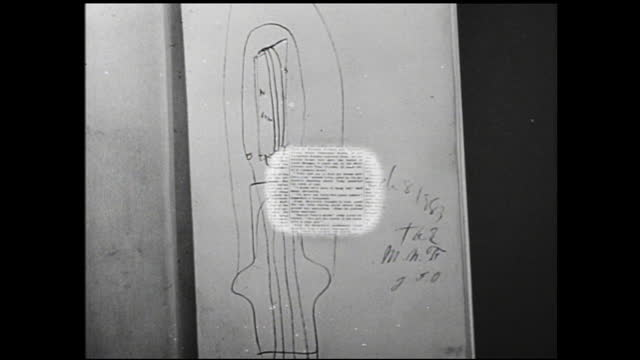 vídeos de stock, filmes e b-roll de tilt up view of wall full of vacuum tubes; close up of hand holding up vacuum tube; still photographs of thomas edison's house and laboratory;... - 1940 1949