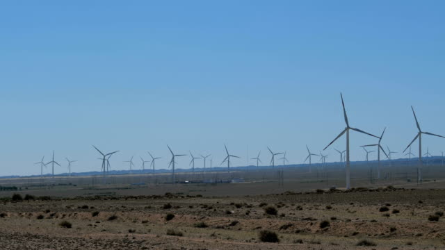 tilt up view of wind turbines in wilderness area - wilderness area stock videos & royalty-free footage