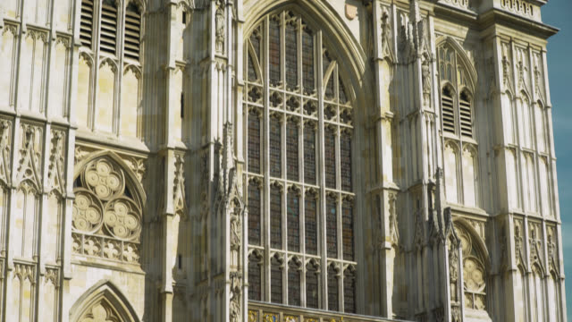 tilt up western facade of westminster abbey - female likeness stock videos & royalty-free footage