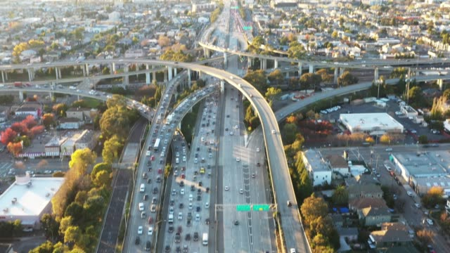 tilt up, wide aerial of busy city freeway - oakland california stock videos & royalty-free footage