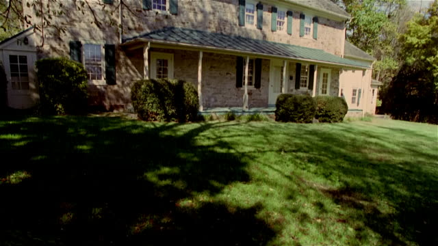 tilt up wide shot exterior view of stone house - stone house stock videos & royalty-free footage