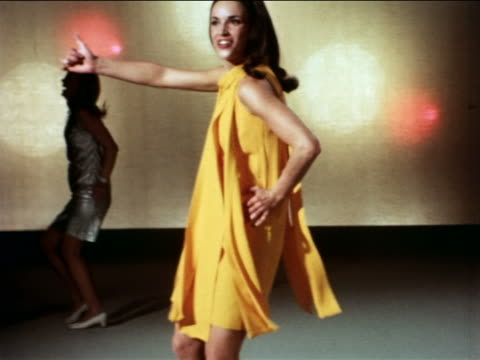 1967 tilt up woman in yellow dress dancing early disco-style in studio / industrial - prelinger archive stock-videos und b-roll-filmmaterial