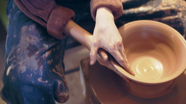 cu tilt up, women's hands shaping a bowl on a potter's wheel - workshop stock videos & royalty-free footage