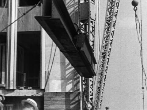 B/W 1930/31 tilt up workers by crane lifting beam in Empire State Bldg construction / NYC / industrial