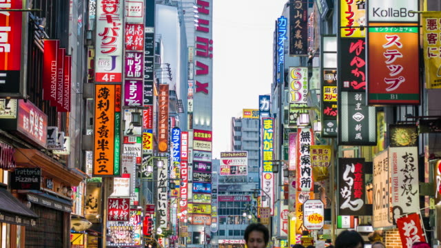 tilt video of people in the streets of shinjuku at sunset - t shirt stock videos & royalty-free footage