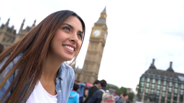 tilt view and close up of a tourist female enjoying the view - big ben stock videos & royalty-free footage