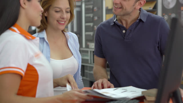 tilt view of excited couple looking at floor samples - material stock videos & royalty-free footage