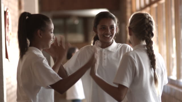 MS TILT_Schoolgirls doing clapping game in the isle